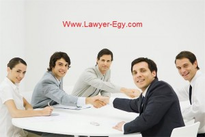 695-05767966 © Masterfile Royalty-Free Model Release: Yes Property Release: No Business associates shaking hands across table, smiling at camera